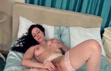 Sophia Delane rubs her hairy pussy