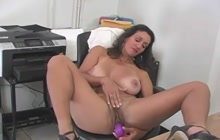 MILF playing with herself in the office
