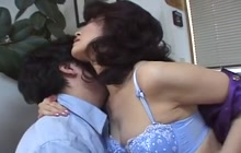 Japanese mommy taking a young cock